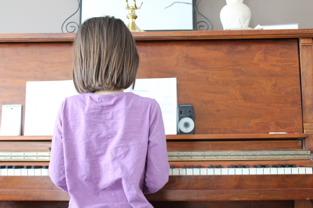 Anika playing piano